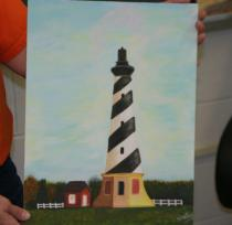 Shelby holding lighthouse